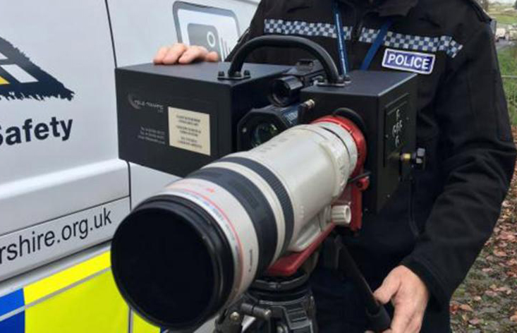 Police Officer showing off new Long Range Speed Camera